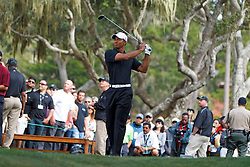 Feb 10, 2012; Pebble Beach CA, USA; Tiger Woods hits his tee shot on the fifth hole during the second round of the AT&T Pebble Beach Pro-Am at Monterey Peninsula Country Club. Mandatory Credit: Jason O. Watson-US PRESSWIRE