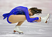 U.S. figure skater Emily Hughes performs during the Short Program of the Women's Figure Skating competition at the Palavela ice arena in Turin, Italy on February 21, 2006. U.S. figure skater Sasha Cohen leads in the event with a score of 66.73. Teammate Kimmie Meissner is in fifth with 59.40 points and Emily Hughes is in seventh with 57.08. Hughes was a last minute replacement for Michelle Kwan who had to withdraw from the Olympics due to injury..(Photo by Marc Piscotty / © 2006)