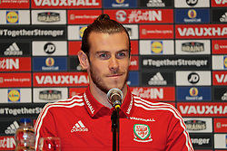 DINARD, FRANCE - Thursday, June 23, 2016: Wales' Gareth Bale during a press conference at their base in Dinard as they prepare for the Round of 16 match during the UEFA Euro 2016 Championship. (Pic by David Rawcliffe/Propaganda)