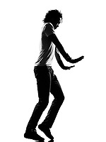 full length silhouette of a young man dancer moonwalk dancing funky hip hop r&b on  isolated  studio white background