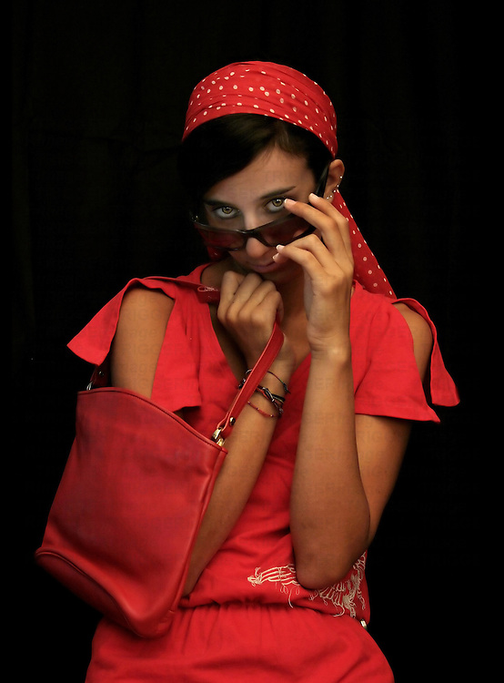 A smart young lady dressed in red with ared scarf and red handbag