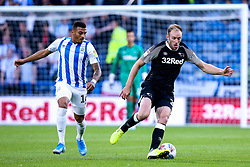 Matthew Clarke of Derby County takes on Karlan Grant of Huddersfield Town - Mandatory by-line: Robbie Stephenson/JMP - 05/08/2019 - FOOTBALL - The John Smith's Stadium - Huddersfield, England - Huddersfield Town v Derby County - Sky Bet Championship