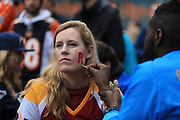 Washington Redskins fan get her face painted during the International Series match between Washington Redskins and Cincinnati Bengals at Wembley Stadium, London, England on 30 October 2016. Photo by Jason Brown.