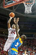 FAYETTEVILLE, AR - NOVEMBER 13:  Jimmy Whitt #24 of the Arkansas Razorbacks goes up for a shot over Adrian Rodgers #2 of the Southern University Jaguars at Bud Walton Arena on November 13, 2015 in Fayetteville, Arkansas.  The Razorbacks defeated the Jaguars 86-68.  (Photo by Wesley Hitt/Getty Images) *** Local Caption *** Jimmy Whitt; Adrian Rodgers