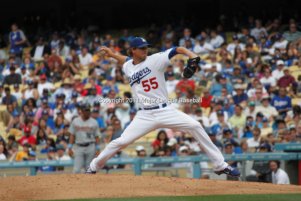LOS ANGELES - JUNE 19:  Relief pitcher Matt Guerrier #55 of the Los Angeles Dodgers throws a pitch during the game against the Houston Astros at Dodger Stadium on Sunday, June 19, 2011 in Los Angeles, California.  The Dodgers defeated the Astros 1-0.  (Photo by Paul Spinelli/MLB Photos via Getty Images) *** Local Caption *** Matt Guerrier