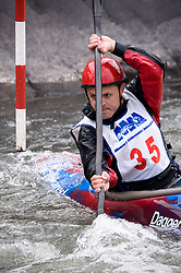 Pete Larson of Ballwin, Missouri races in the K1 men's senior plastic class during the slalom course of the 42nd Annual Missouri Whitewater Championships. Larson placed first place in the class. The Missouri Whitewater Championships, held on the St. Francis River at the Millstream Gardens Conservation Area, is the oldest regional slalom race in the United States.