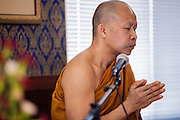 "11 MARCH 2012 - CHANDLER, AZ:   The Abbot leads a chanting service in the ""bot"" or ordination hall during Makha Bucha Day services at Wat Pa in Chandler, AZ, Sunday. Magha Puja (also spelled Makha Bucha) Day marks the day 2,500 years ago that 1,250 Sangha came spontaneously to see the Buddha who preached to them on the full moon. All of them were ""Arhantas"" or Enlightened Ones who had been personally ordained by the Buddha. The Buddha gave them the principles of Buddhism, called ""The Ovadhapatimokha."" Those principles are: to cease from all evil, to do what is good, and to cleanse one's mind. It is one of the most important holy days in the Theravada Buddhist tradition. At the temple, people participate in the ""Tum Boon"" (making merit by listening to the monk's preaching and giving a donation to the temple), the ""Rub Sil"" (keeping of the Five Precepts including the abstinence from alcohol and other immoral acts) and the ""Tuk Bard"" (offering food to the monks in their alms bowls). It is a day for veneration of the Buddha and his teachings. It's a legal holiday in Thailand, Laos, Cambodia and Myanmar (Burma).       PHOTO BY JACK KURTZ"