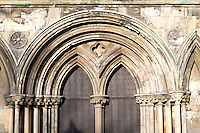 13th century Early English door at Beverley Minster south transept, Yorkshire, UK. With stiff leaf capitals, dogtooth banding to arches and sunken quatrefoil to spandrel.