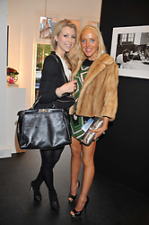 Left to right, ELLE JOHN and CLARE VAN DAM at a private view of the late Patrick Lichfield: Nudes at The Little Black gallery, 13A Park Walk, London SW10 on 26th April 2012.