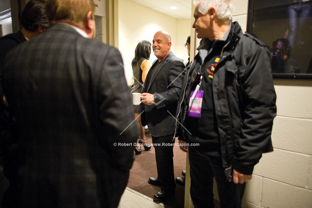 Billy Joel in his dressing room at the 12-12-12 fundraising concert to aid the victims of Hurricane Sandy, will take place on December 12, 2012 at Madison Square Garden. The concert featured The Rolling Stones, Bon Jovi, Eric Clapton, Dave Grohl, Billy Joel, Alicia Keys, Chris Martin, Bruce Springsteen & the E Street Band, Eddie Vedder, Roger Waters, Kanye West, The Who, and Paul McCartney. All the proceeds went go to the Robin Hood Relief Fund. Robin Hood, the largest independent poverty fighting organization in the New York area, will insure that every cent raised will go to non-profit groups that are helping the tens of thousands.of people throughout the tri-state area who have been affected by Hurricane Sandy...Photo © Robert Caplin..