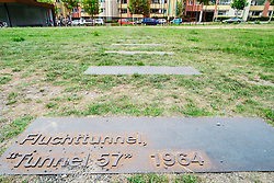 Plaque marks location of escape tunnel 57 in former death strip of Berlin Wall on Bernauer Strasse  in Berlin Germany