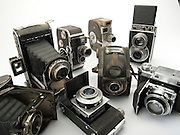 an assortment of old style film cameras