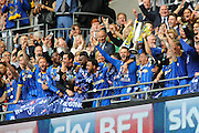 AFC Wimbledon players raise the play off final cup during the Sky Bet League 2 play off final match between AFC Wimbledon and Plymouth Argyle at Wembley Stadium, London, England on 30 May 2016. Photo by Graham Hunt.
