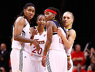 INDIANAPOLIS, IN - OCTOBER 21: Erlana Larkins #2 of the Indiana Fever, Briann January #20 of the Indiana Fever, Shavonte Zellous #1 of the Indiana Fever and Erin Phillips #13 of the Indiana Fever watch free throws during the closing minutes against the Minnesota Lynx during Game Four of the 2012 WNBA Finals on October 21, 2012 at Bankers Life Fieldhouse in Indianapolis, Indiana. NOTE TO USER: User expressly acknowledges and agrees that, by downloading and or using this Photograph, user is consenting to the terms and conditions of the Getty Images License Agreement. (Photo by Michael Hickey/Getty Images) *** Local Caption *** Erlana Larkins; Briann January; Shavonte Zellous; Erin Phillips