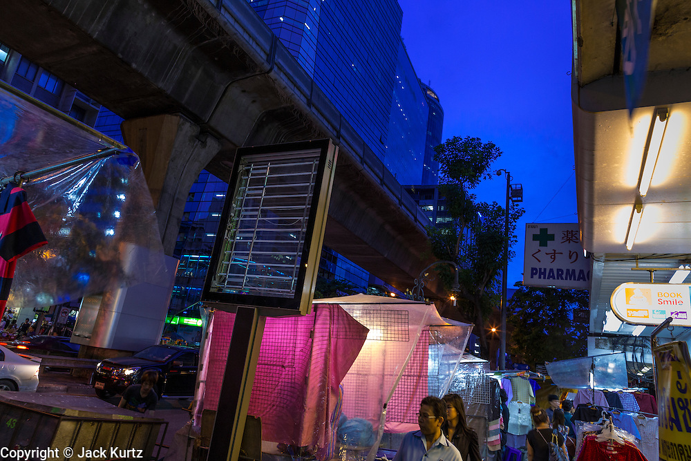 4 JUNE 2013 - BANGKOK, THAILAND:  Silom Road near the Patpong Night Bazaar in Bangkok. Patpong was one of Bangkok's notorious red light districts but has been made over as a night market selling clothes, watches and Thai handicrafts. The old sex oriented businesses still exist but the area is now better known for its night shopping.      PHOTO BY JACK KURTZ
