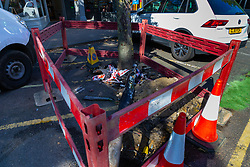 Barriers surround the remains of a downed streetlight as workers clear up the debris following a high speed crash involving two high performance cars on Chiselhurst High Street in South East London. London, August 22 2019.