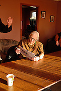 "Mary Garvey reads a newspaper at the University of Windsor Ontario Public Interest Reseasch Group (OPIRG). Garvey and others went to the office for coffee after an ""Idle No More"" round dance event. ""Idle No More"" is a native rights movement."