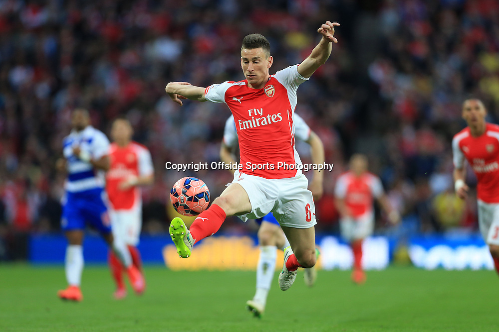 18th April 2015 - FA Cup - Semi-Final - Reading v Arsenal - Laurent Koscielny of Arsenal stretches to control the ball - Photo: Simon Stacpoole / Offside.