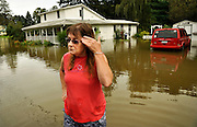 "Sandra Ledford stands in several feet of water flooding her Candor, N.Y., property, Thursday, September 8, 2011. ""This is a tragedy,"" said Ledford, who moved into the home five years ago..(AP Photo/Heather Ainsworth)"