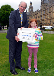 © Licensed to London News Pictures. 14/05/2013. Westminster, UK Nick Harvey MP, Alicia Thelwell. Patients campaigning for a life-saving treatment to be made available for all sufferers of the rare blood disease atypical Haemolytic Uraemic Syndrome (aHUS) present an urgent petition with over 30,000 signatures to MPs at the House of Commons on Tuesday May 14 2013... Photo credit : Stephen Simpson/LNP