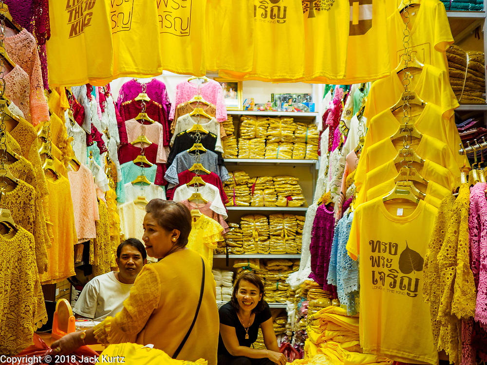 "03 JULY 2018 - BANGKOK, THAILAND: A shop that sells yellow tee shirts that say ""Long Live the King"" in Bobae Market in Bangkok. The birthday of King Maha Vajiralongkorn Bodindradebayavarangkun, Rama X, is 28 July. The King, the only son of Thailand's late King Bhumibol Adulyadej, became the King of Thailand in 2016 after the death of his father. King Vajiralongkorn was born on 28 July 1952, a Monday. In Thai culture each day of the week has a color, and yellow is the color is associated with Monday, so people wear yellow for the month before his birthday to honor His Majesty.    PHOTO BY JACK KURTZ"