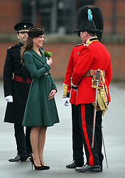 Catherine, Duchess of Cambridge receives a sprig  of shamrock  at the 1st Battalion Irish Guards  St Patricks Day Parade at Mons Barracks, Aldershot, Saturday 17th March 2012. .Photo by: Stephen Lock / i-Images