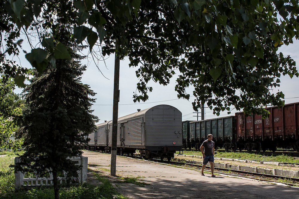 TOREZ, UKRAINE - JULY 20: Refrigerated train cars holding the bodies of passengers from Malaysia Airlines flight MH17 wait at the train station for transport to an unknown location on July 20, 2014 in Torez, Ukraine. Malaysia Airlines flight MH17 was travelling from Amsterdam to Kuala Lumpur when it crashed killing all 298 on board including 80 children. The aircraft was allegedly shot down by a missile and investigations continue over the perpetrators of the attack. (Photo by Brendan Hoffman/Getty Images) *** Local Caption ***