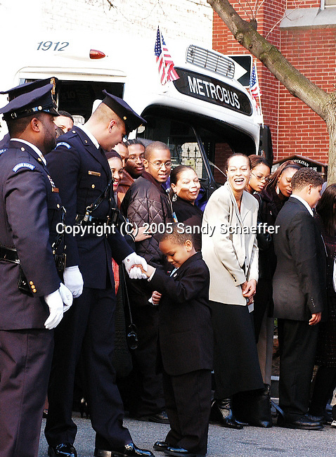 Skyler Brown, Rosa Parks Great Nephew shakes hands with a member of the Honor Guard before her funeral Services at the AME Church in Washington, D.C.