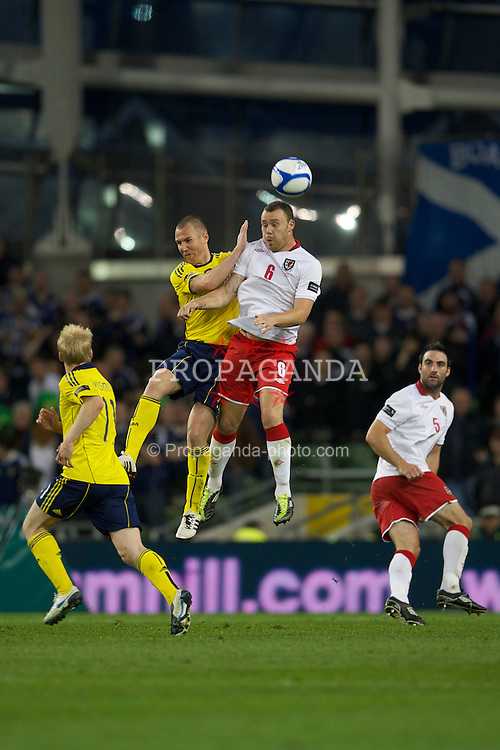 DUBLIN, REPUBLIC OF IRELAND - Wednesday, May 25, 2011: Wales' Darcy Blake and Scotland's Scott Brown during the Carling Nations Cup match at the Aviva Stadium (Lansdowne Road). (Photo by David Rawcliffe/Propaganda)
