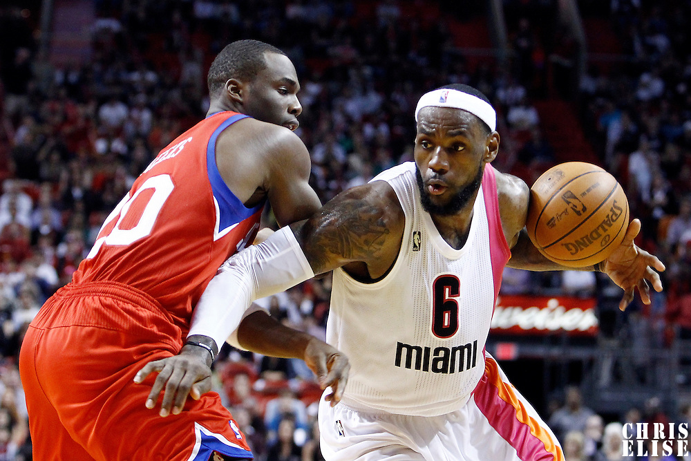 21 January 2012: Miami Heat small forward LeBron James (6) drives past Philadelphia Sixers guard Jodie Meeks (20) during the Miami Heat 113-92 victory over the Philadelphia Sixers at the AmericanAirlines Arena, Miami, Florida, USA.