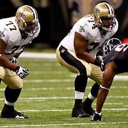 August 21, 2010; New Orleans, LA, USA; New Orleans Saints guard Carl Nicks (77) and offensive tackle Jermon Bushrod (74) line up during the first quarter of a preseason game against the Houston Texans at the Louisiana Superdome. Mandatory Credit: Derick E. Hingle