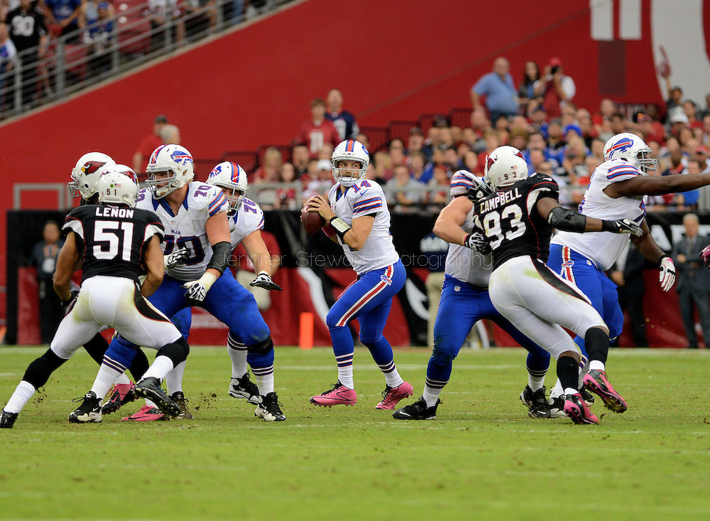 Oct. 14, 2012; Glendale, AZ, USA; Buffalo Bills quarterback Ryan Fitzpatrick (14) looks to make a pass during the game against the Arizona Cardinals at University of Phoenix Stadium. The Bills defeated the Cardinals 19-16 in overtime. Mandatory Credit: Jennifer Stewart-US PRESSWIRE