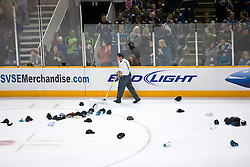 October 8, 2009; San Jose, CA, USA; A member of the San Jose Sharks staff shovels hats thrown on the ice after right wing Dany Heatley (not pictured) scored a hat trick during the third period against the Columbus Blue Jackets at HP Pavilion. San Jose won 6-3. Mandatory Credit: Jason O. Watson / US PRESSWIRE