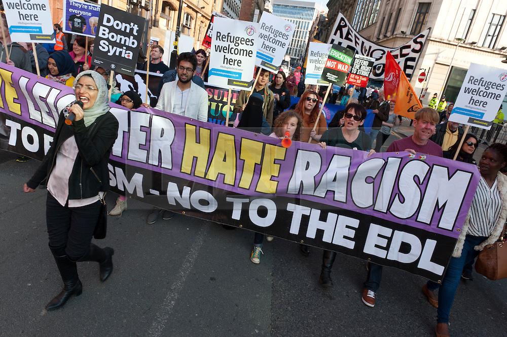 © Licensed to London News Pictures. 04/10/2015. An estimated 85 thousand take part in a National Demonstration march through the city. A week of pro-peace, anti-austerity, anti-war, anti-Tory, protests dubbed 'Take Back Manchester' has been  organised by The People's Assembly and timed to coincide with the Conservative Party Conference in Manchester on 4th - 7th Oct 2015. Over 40 events are planned, including a speech by new Labour leader Jeremy Corbyn timed to compete with closing speech of Tory leader David Cameron. Photo credit: Graham M. Lawrence/LNP