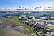 Nederland, Friesland, Gemeente Dongeradeel, 28-02-2016; Paesens-Moddergat, twee dorpen gelegen aan de Waddenkust, achter de zeedijk van de Waddenzee. In de achtergrond de voormalige Lauwerszee (nu Lauwersmeer).<br /> Twin villages located on the Wadden Sea, behind the dike of the Wadden Sea.<br />  <br /> luchtfoto (toeslag op standard tarieven);<br /> aerial photo (additional fee required);<br /> copyright foto/photo Siebe Swart