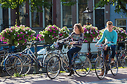 Young couple on bicycles in streets of Amsterdam, Holland