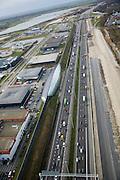 Nederland, Utrecht, Leidsche Rijn, 04-03-2008; A2 met de cockpit, autoshowroom voor luxe automobielen van Hessing, onderdeel van het monumentale geluidsscherm, achter de geluidswal het bedrijventerein Leidsche Rijn; de 1500 m lange vakwerkconstructie van staal en glas is van architect Oosterhuis (ONL architects);. .luchtfoto (toeslag); aerial photo (additional fee required); .foto Siebe Swart / photo Siebe Swart . .