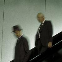 Older men walking down an escalator in the Washington, DC Metro system.