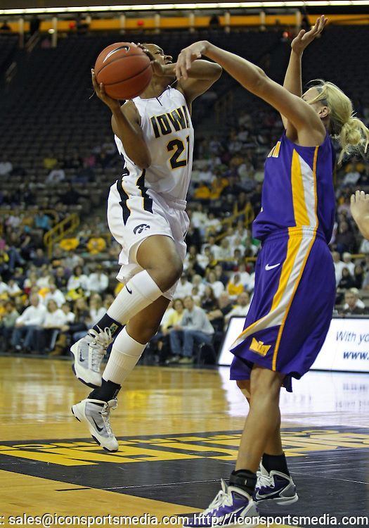 December 22 2010: Iowa guard Kachine Alexander (21) puts up a shot against Northern Iowa guard/forward Erin Brocka (44) during the first half of an NCAA college basketball game at Carver-Hawkeye Arena in Iowa City, Iowa on December 22, 2010. Iowa defeated Northern Iowa 75-64.