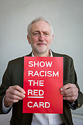 Labour leader Jeremy Corbyn shows racism the red card at an event at Arsenal's  Emirates stadium, Islington, London, UK. 8th February 2018. (photo by Andrew Aitchison / In pictures via Getty Images)
