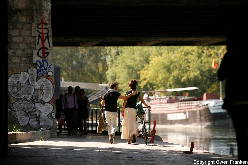 Bicycling along the Canal d'Ourcq, in Paris near Cité de la Villette..September 16, 2012..Photograph by Owen Franken for the NY Times