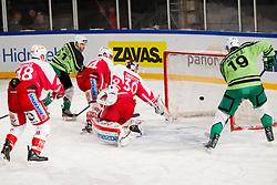 08.01.2012, Stadium Bezigrad, Ljubljana, SLO, EBEL, HDD Telemach Olimpija Ljubljana vs KAC Klagenfurt 40. Runde, in picture Kevin De Vergilio (HDD Telemach Olimpija, #51) and Ziga Pance (HDD Telemach Olimpija, #19) vs Rene Swette of KAC during the Erste Bank Ice Hockey League in 40th Round match between HDD Telemach Olimpija Ljubljana and KAC Klagenfurt at the open ice winter classic Stadium Bezigrad, Ljubljana, Slovenia on 2013/01/08. (Photo By Vid Ponikvar / Sportida.com)