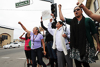 Several hundred protesters gathered on Wednesday afternoon at the scene of Tuesday's officer-involved shooting near the Sanborn Plaza Market at the corner of Del Monte Avenue and North Sanborn Road in Salinas.