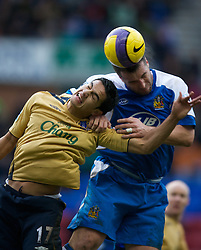 Wigan, England - Sunday, January 21, 2007: Wigan Athletic's David Unsworth and Everton's Tim Cahill during the Premier League match at the JJB Stadium. (Pic by David Rawcliffe/Propaganda)