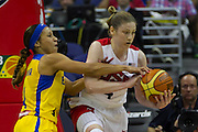 Team USA guard Lindsay Whalen (4) grabs this loose ball from Team Brazil guard Adriana Pinto (4)during the 2012 USA Women's Basketball Team versus Brazil at Verizon Center in Washington, DC.  July 16, 2012  (Photo by Mark W. Sutton)