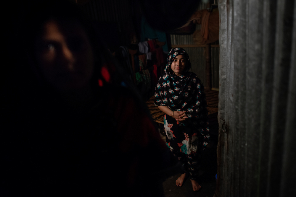 20141012 Dhaka<br /> Hafiza Becum, 21, and Shumi Becum, 20, both worked at the factory for 1 year. They both have a son each, abut Hafizas son has to live with her husbands parents back in their village.<br />  &ndash; i would have liked to work in the village instead, she says, but there are no jobs there.<br /> The minimum wages was raised in 2013 in Bangladesh, but the living wage, whats left to live on after expenses, is actually lower now than before 10 years ago, according to the women in 7 story slum in central Dhaka.<br /> Photo: Vilhelm Stokstad / Kontinent