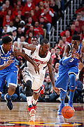 LOUISVILLE, KY - DECEMBER 29: Russ Smith #2 of the Louisville Cardinals battles for the ball against Nerlens Noel #3 and Archie Goodwin #10 of the Kentucky Wildcats at the KFC Yum! Center in Louisville, Kentucky. Louisville won 80-77. (Photo by Joe Robbins)