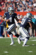 Dallas Cowboys quarterback Dak Prescott (4) looks to hand off the ball on a running play to Dallas Cowboys running back Ezekiel Elliott (21) during the 2016 NFL week 9 regular season football game against the Cleveland Browns on Sunday, Nov. 6, 2016 in Cleveland. The Cowboys won the game 35-10. (©Paul Anthony Spinelli)