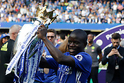 Chelsea Midfielder Ngolo Kante (7) celebrates with the trophy during the Premier League match between Chelsea and Sunderland at Stamford Bridge, London, England on 21 May 2017. Photo by Andy Walter.