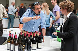 © Licensed to London News Pictures. 16/05/2016. London, UK. A wine maker meets a potential buyer. Buyers and wine lovers visit the Raw Wine Fair at the Old Truman Brewery near Brick Lane.  The fair brings over 180 artisan growers and wine makers from around the world who specialise in producing organic, biodynamic and naturally made wines with minimal additives. Photo credit : Stephen Chung/LNP